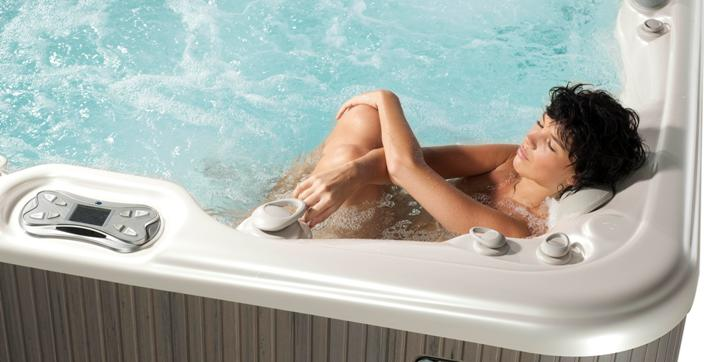 mom relaxes hot tub 1