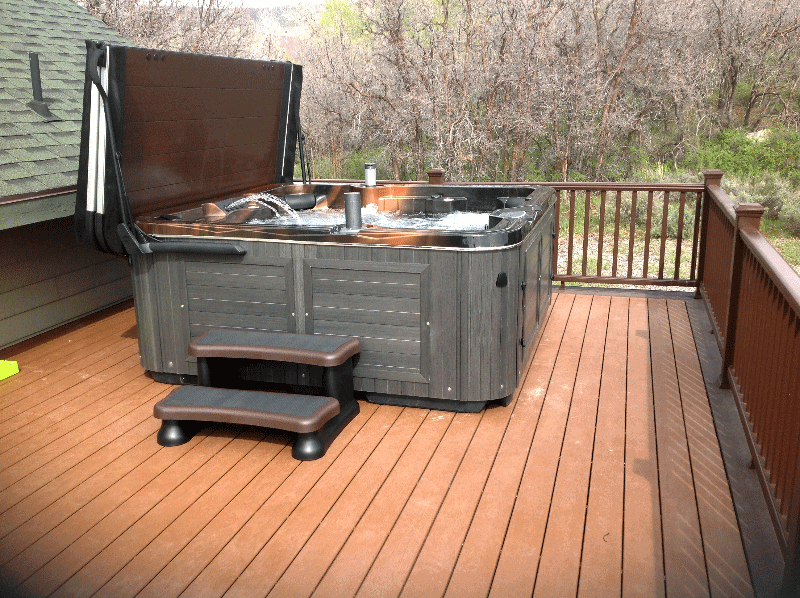 Arctic Spas Hot tub with an open cover on deck